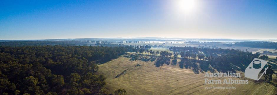 aerial photo showing Australian farm land with distant horizon and fog