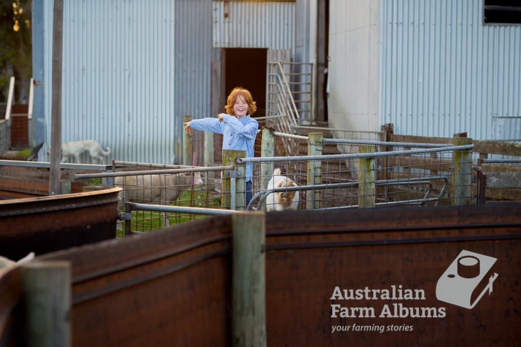 Photo of a farm kid near a shed