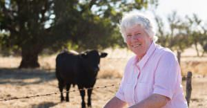 Photograph of farmer with Angus stud bull on Australian Farm