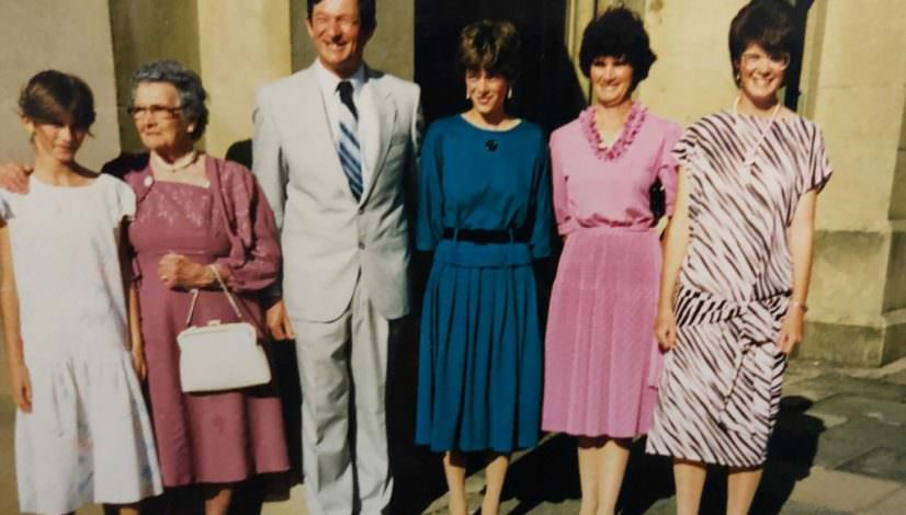 An old family photo with a group of people at a wedding