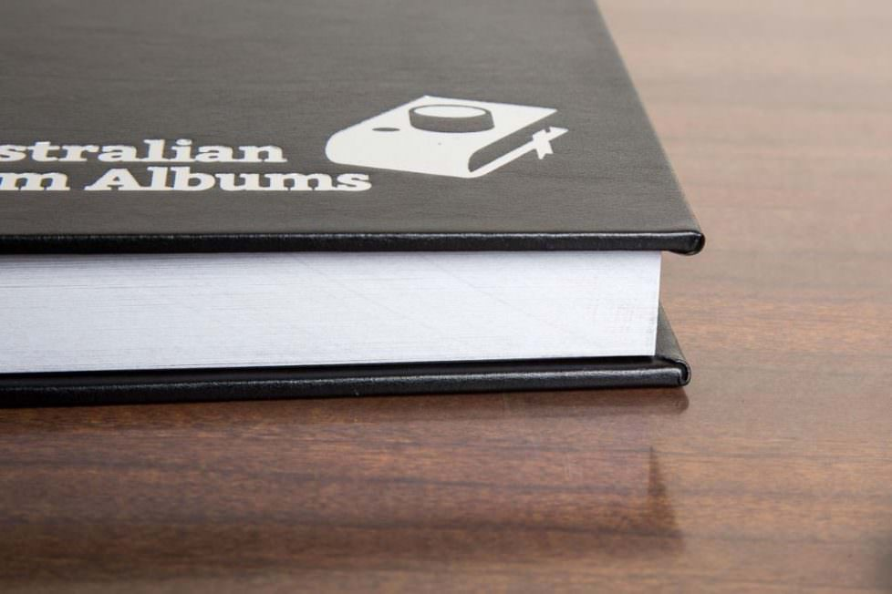 Photo of detail of the quality binding of an Australian Farm Album is a hardcover coffee-table style photo book.