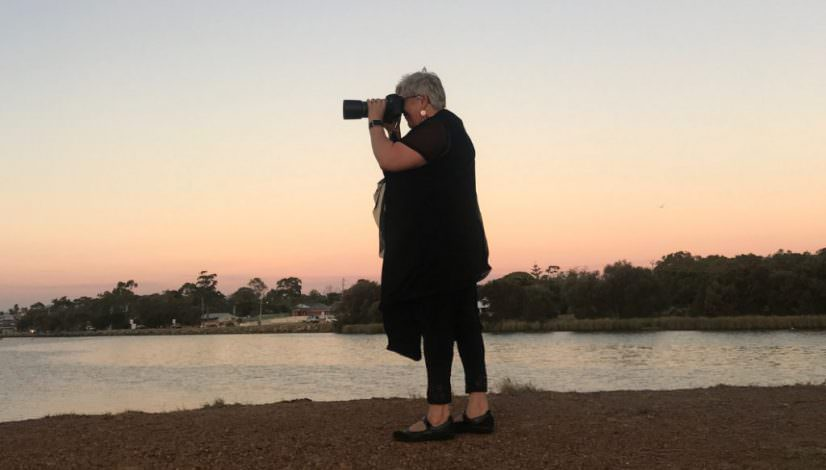 Photo of Caro Telfer taking photographs